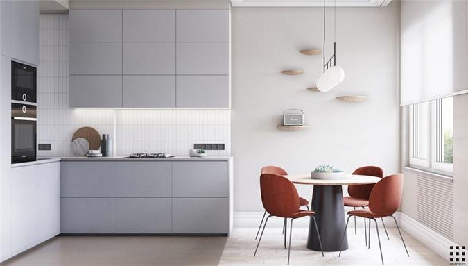 Cửa kính trượt phía sau ghế sofa dẫn đến một nhà bếp nhỏ riêng biệt. Không gian ở đây được phân chia gần như chính xác giữa bàn ăn và tủ bếp.