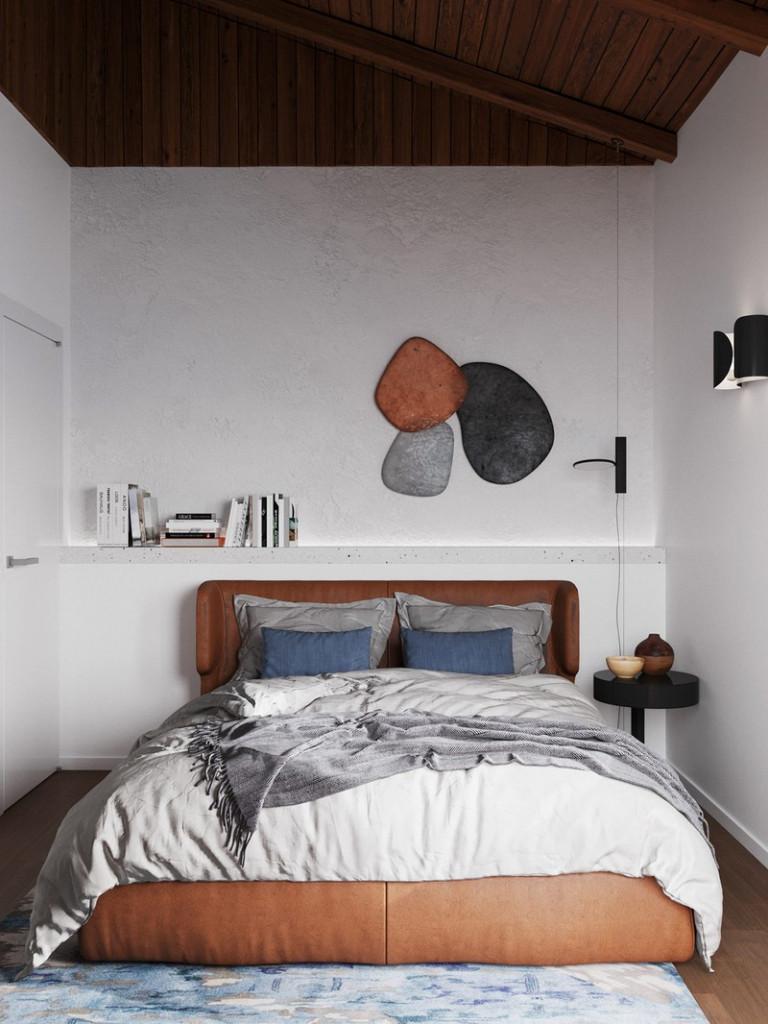 Chiếc giường ngủ bọc da mang lại màu sắc ấm cúng cho khu vực giường ngủ thứ 2. Bức tranh đầu giường đẩy cao yếu tố nghệ thuật cho căn phòng.