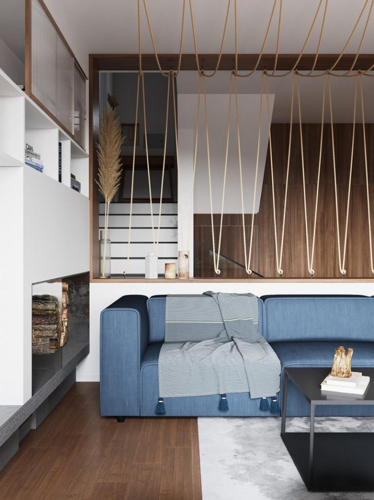 Trong phòng khách, một chiếc ghế sofa hiện đại màu xanh cộng với dây thừng kết theo dạng lưới, khiến ta liên tưởng đến cuộc sống của một ngư dân sống gần biển