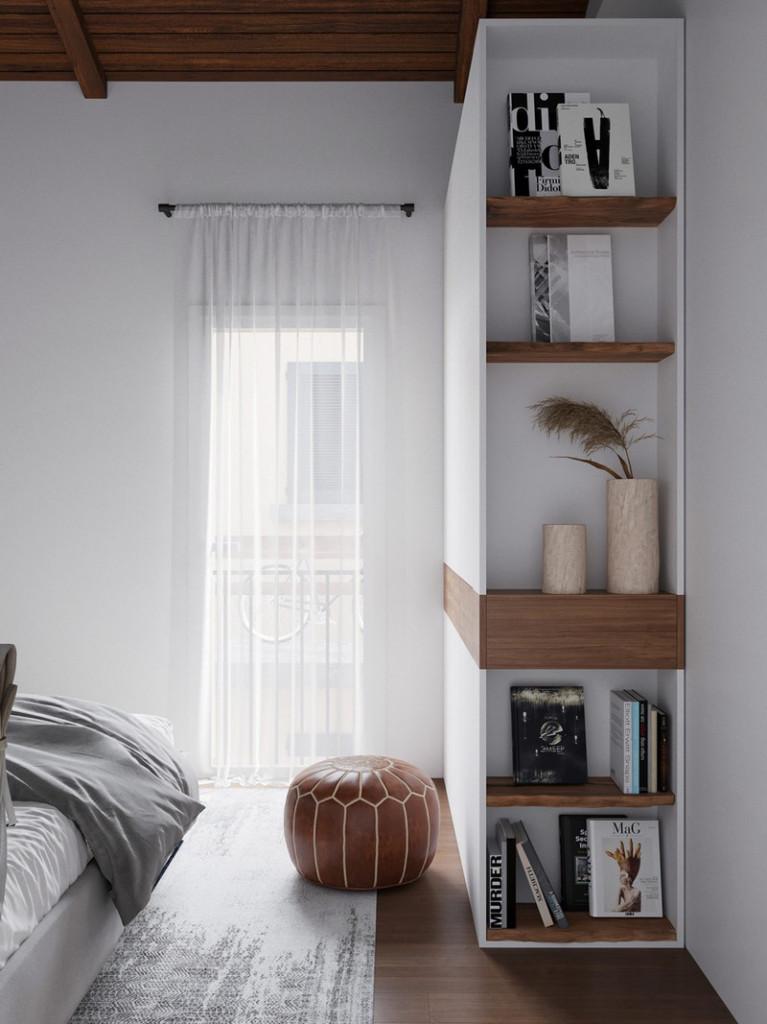 Một chiếc ghế đệm bọc da, đặt cạnh giá sách âm tường