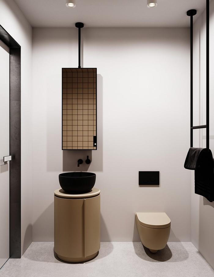 Nội thất phòng tắm khá đặc biệt với màu be độc đáo, tương phản với những bức tường màu xám