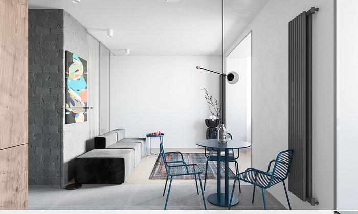 Phòng khách nhỏ với lượng nội thất đơn giản nhất có thể. Nhà thiết kế đã lựa chọn một chiếc bàn đựng hoa quả nhỏ thay vì bàn cà phê lớn. Bộ bàn ăn nhỏ được bố trí ở gần chiếc ghế sofa.