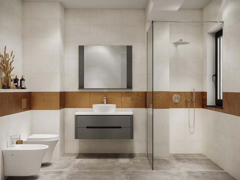 Mảng tường bọc vàng tạo sự liên kết, trong khi phòng tắm ướt và phòng tắm khô vẫn được ngăn cách bởi bức tường kính.