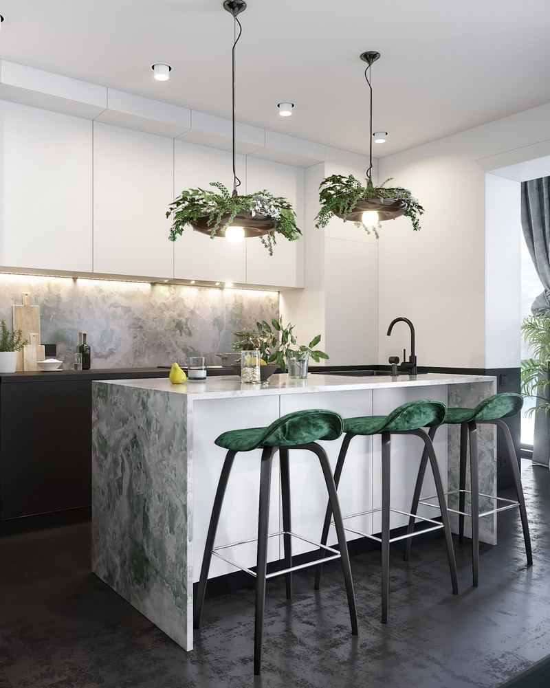 Ba chiếc ghế quầy bar nhà bếp màu xanh lá cây xếp dọc theo một bên để tạo ra khu vực ăn uống thú vị