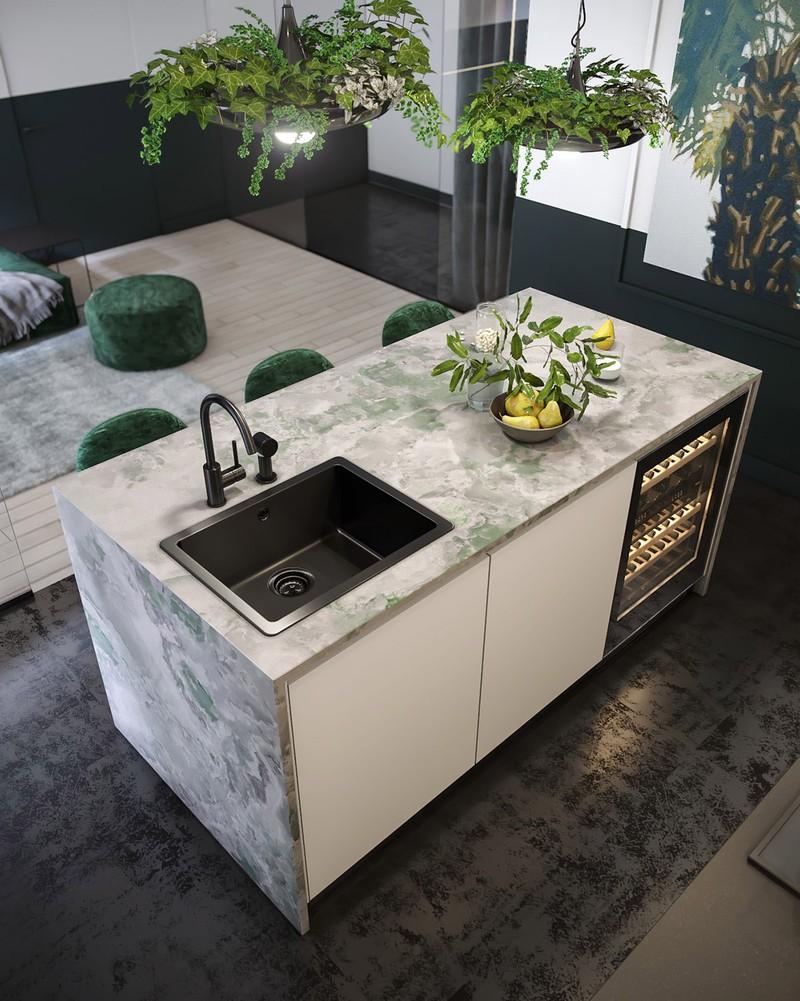 Đảo bếp có tông màu lá cây ép. Ý tưởng đảo bếp đẹp này cũng bao gồm bồn rửa nhà bếp và lưu trữ rượu vang