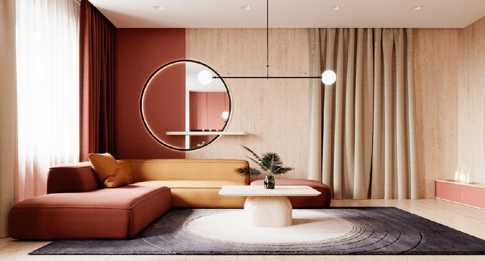 Phòng khách nổi bật với nội thất cam- đỏ- vàng cùng với một tấm gương lớn hình tròn làm bừng sáng không gian