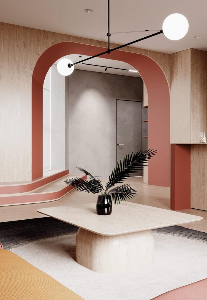 Bàn cà phê hình vuông nằm ở trung tâm của phòng khách. Chiếc bình thủy tinh đen là một yếu tố tạo nên hình ảnh tượng phản với mặt bàn màu trung tính.