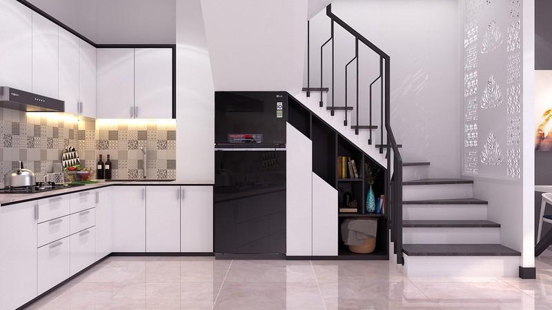 Tủ lạnh màu đen nổi bật giữa hệ thống tủ kệ bếp màu trắng sơn bóng