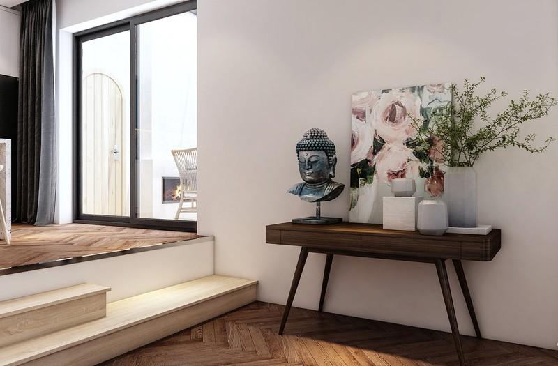 Bên cạnh đó, các yếu tố trang trí như tranh ảnh, bình hoa cũng được khéo léo đưa vào nhà