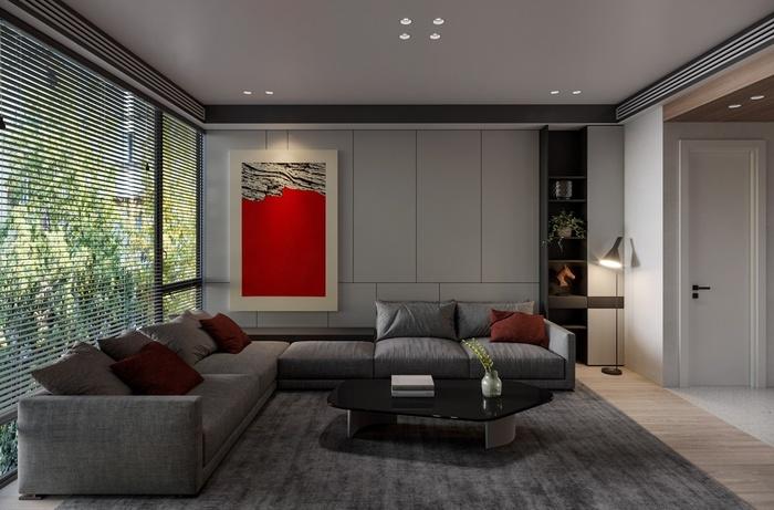 Bức tránh và những chiếc gối màu đỏ giúp không gian thêm phần sống động