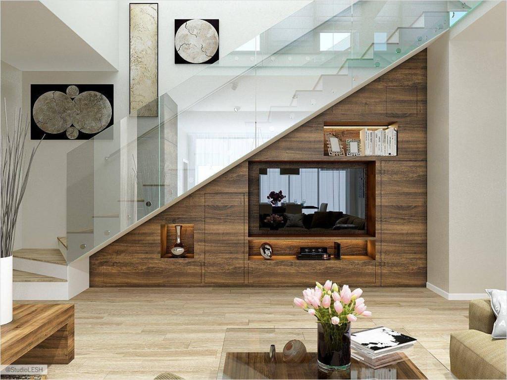 Không gian phòng khách thoáng hơn khi bố trí kệ TV ở gầm cầu thang