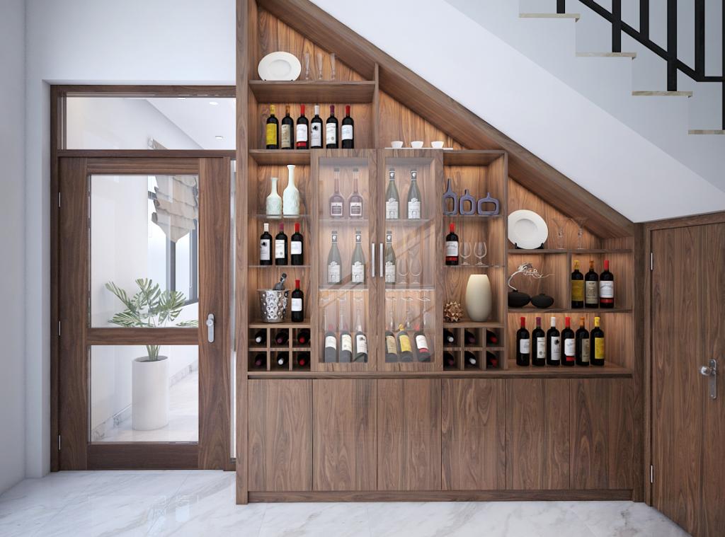 Mặc dù gầm cầu thang có vẻ tối tăm và chật hẹp nhưng chủ nhà cũng có thể tận dụng để làm tủ đựng rượu.