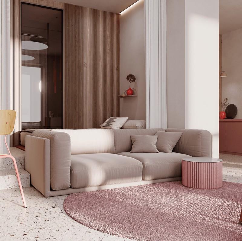 Ghế sofa thấp cho phép ánh sáng đi qua, làm nổi bật màu sắc tường phía sau căn hộ