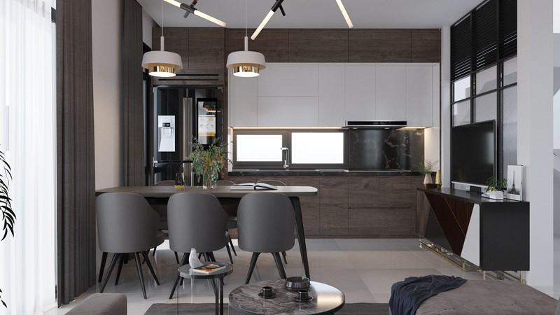 Phòng bếp nằm cạnh phòng khách, sử dụng nhiều đồ nội thất thông minh nhằm tiết kiệm diện tích và giúp gia chủ có thời gian tận hưởng cuộc sống.