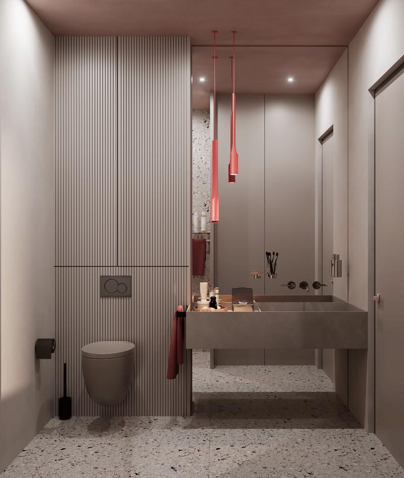 Phòng tắm trong căn hộ trang trí theo phong cách hiện đại, cộng thêm một vài điểm nhấn màu hồng trên đèn và khăn
