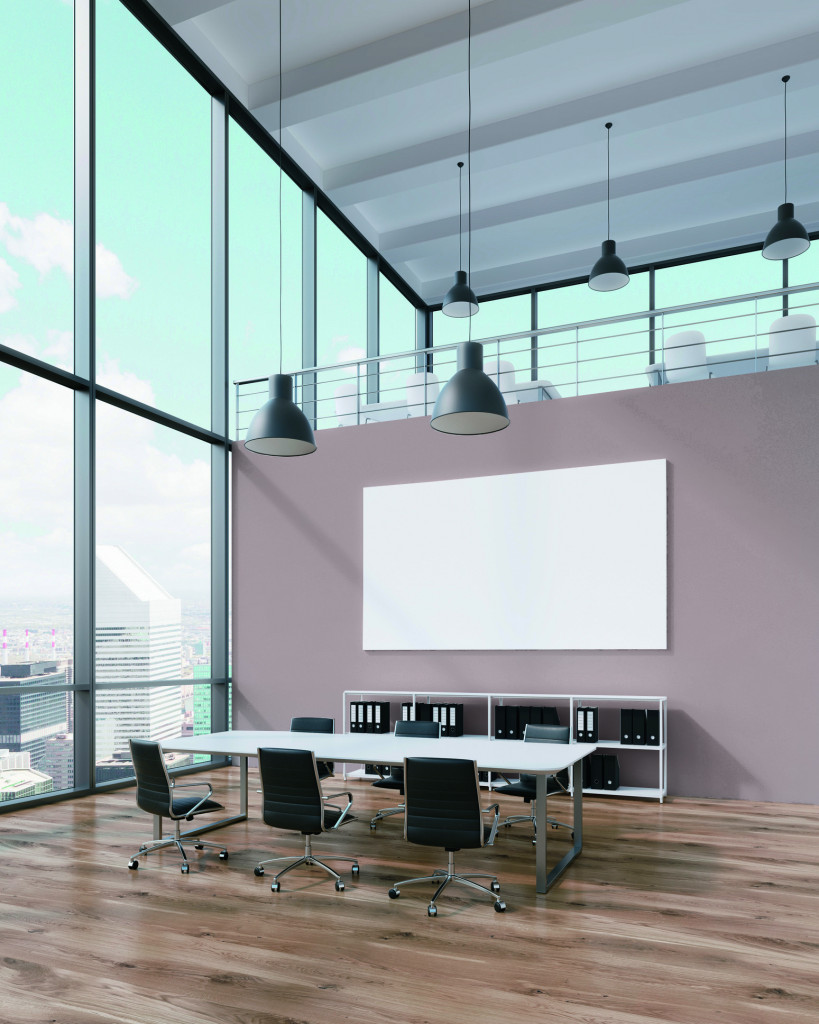 Meeting room with blank poster