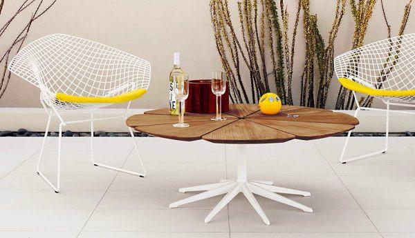 Mặt bàn chế tác hình hoa, làm từ gỗ tếch chịu được mọi điều kiện thời tiết khắc nghiệt