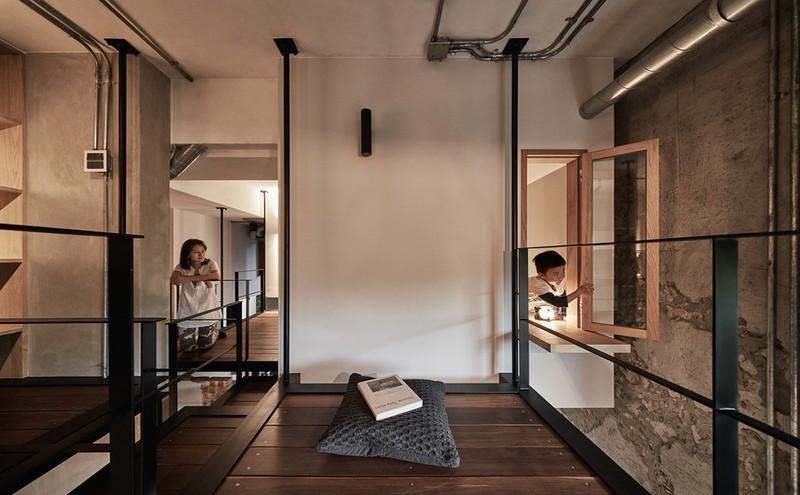 Hai phòng ngủ kết nối với nhau bằng một khoảng chung ở giữa.