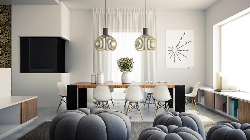 Đèn và bình hoa hình tròn, góp phần làm giảm sự cứng nhắc của góc cạnh bàn gỗ