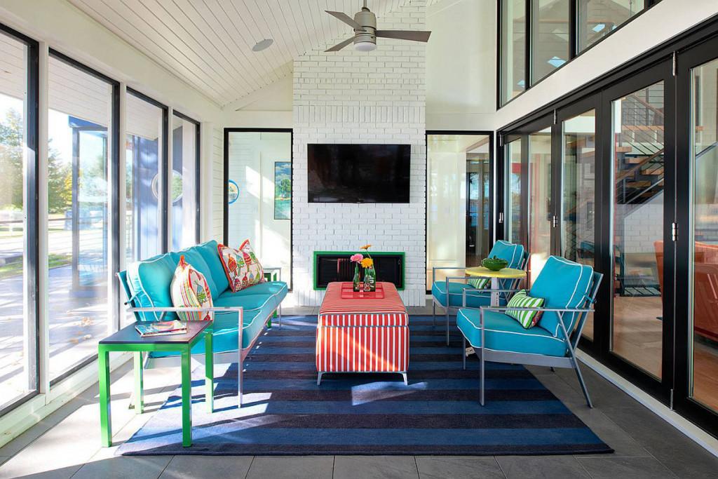 Thảm xanh với sắc độ khác so với ghế để tạo điểm nhấn đặc biệt