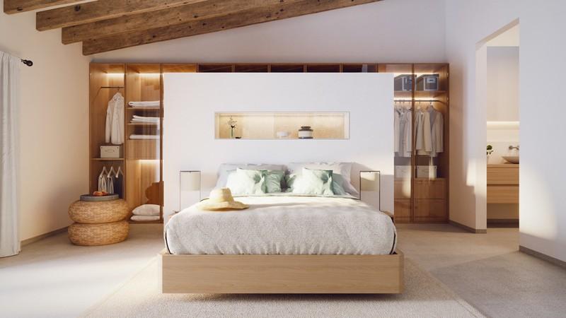 Chiếc giường và tường đầu giường tạo sự riêng tư cho tủ quần áo