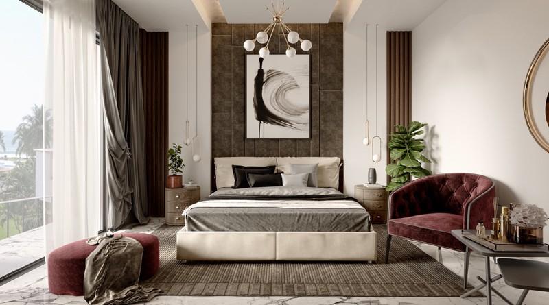 Thảm trải sàn đặt ngay dưới giường để che đi vẻ ngoài lạnh lẽo của đá cẩm thạch. Cách bố trí phòng ngủ cân đối và hài hòa cho thấy sự đầu tư nghiêm túc của người sở hữu.