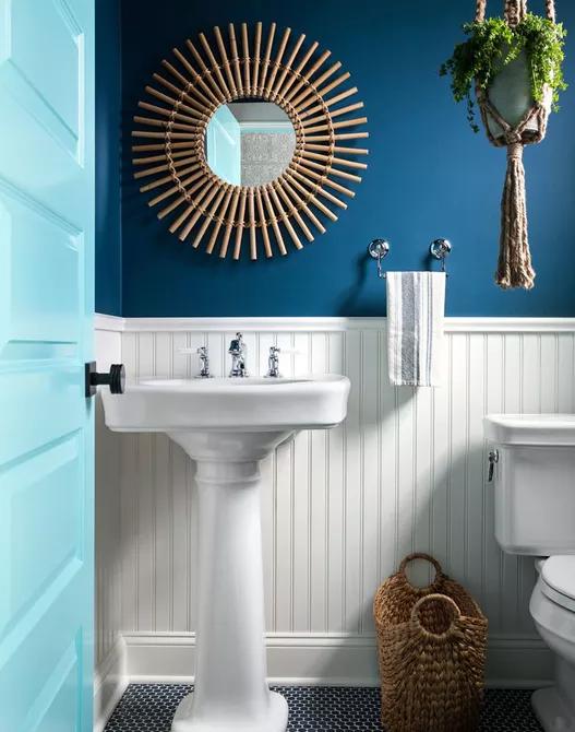 Tường và cửa màu xanh biển kết hợp với sắc trắng và nâu gỗ giúp phòng tắm của con bạn giống như một căn phòng bên bãi biển.