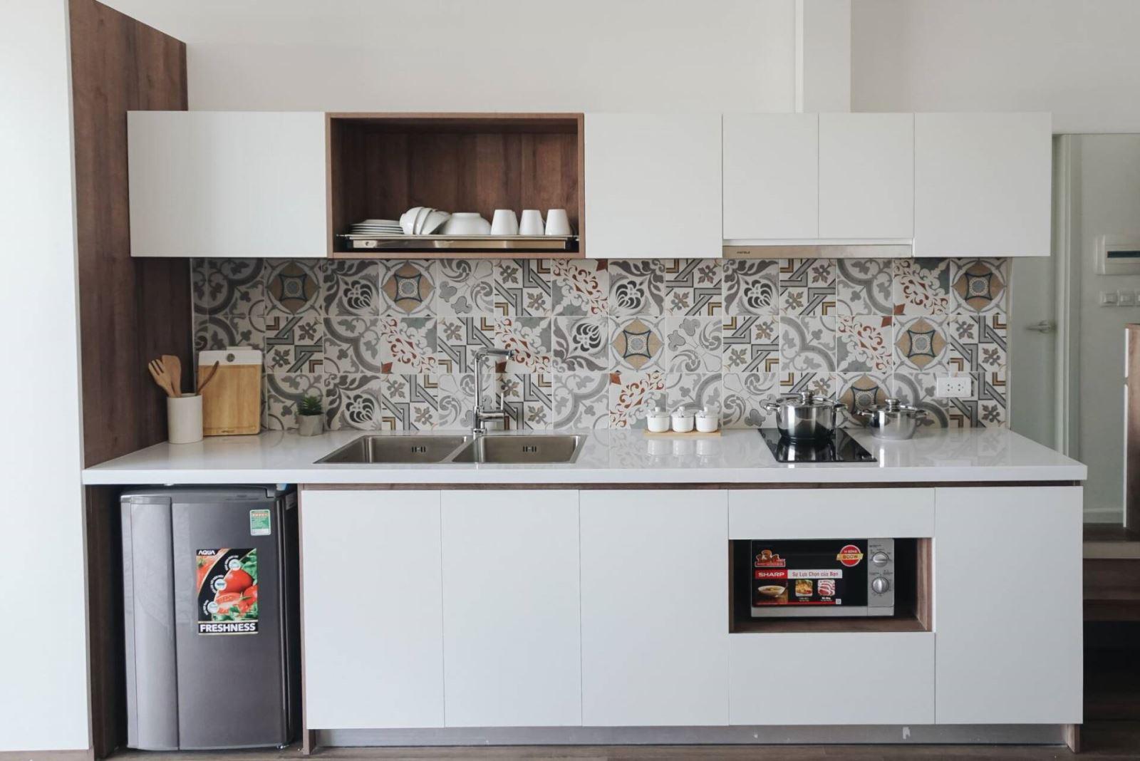 Chất liệu phủ bề mặt Laminate được sử dụng khá nhiều cho khu vực tủ bếp