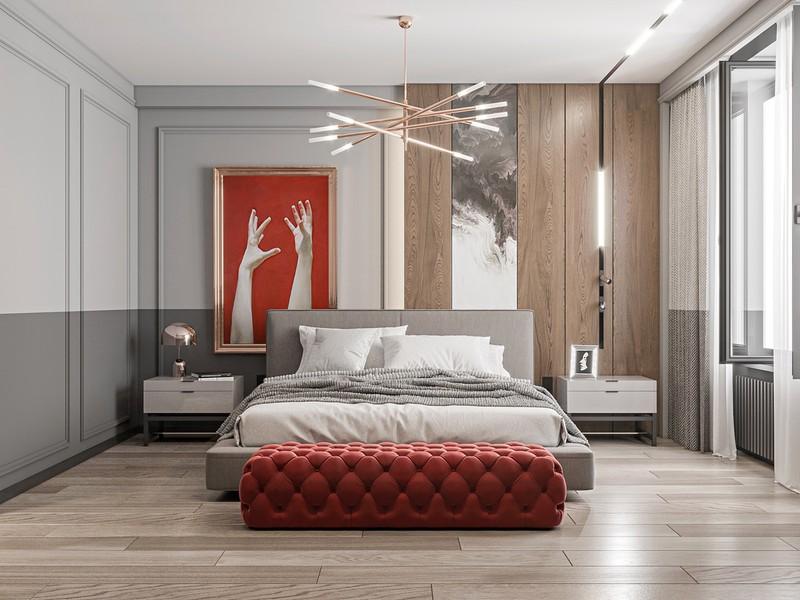 Tranh sơn đỏ và ghế dài mang đến vẻ đẹp cân bằng cho căn phòng ngủ mang màu sắc trung tính.