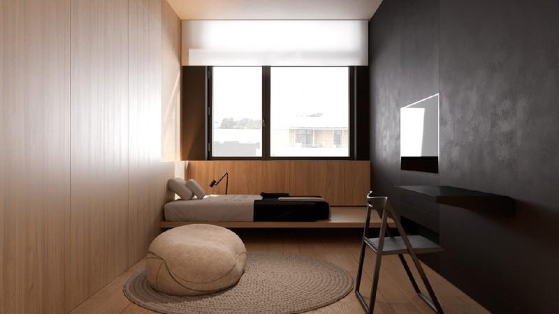 Phòng nhỏ được phân chia theo tỷ lệ 50/50 với hai gam màu than và màu nâu gỗ, tạo nên một thiết kế giường tầng thanh lịch kiểu Nhật
