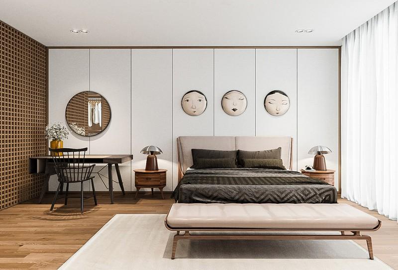Chiếc giường thấp khoe trọn vẻ đẹp của 3 bức tranh nghệ thuật bên trên.