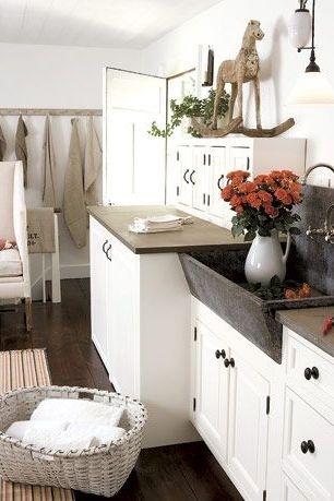 Để có phòng giặt là ấm áp, nhẹ nhàng hơn thì đừng quên chọn gam màu trung tính