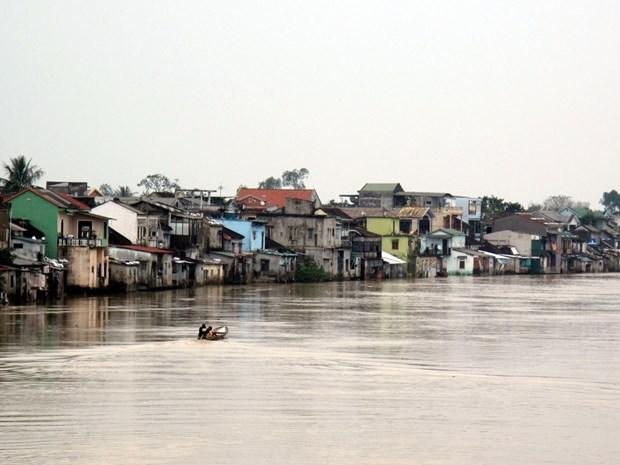 Cử tri tỉnh An Giang cho rằng mức hỗ trợ tiền vay cất nhà (là 25 triệu đồng) không đủ để cất nhà theo giá xây dựng hiện nay. (Nguồn ảnh: Quốc Việt/TTXVN)