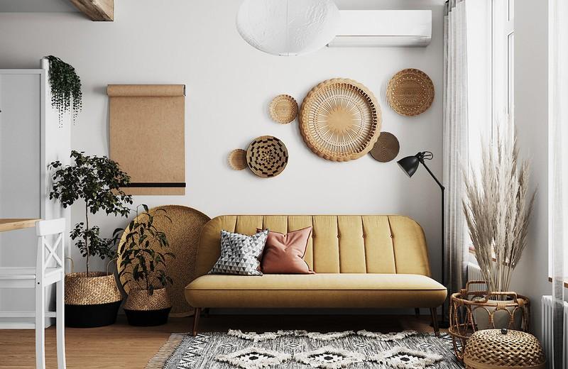 Ghế sofa màu nâu nhạt phù hợp với màu sắc của những vật dụng trang trí bằng mây tre đan trong phòng
