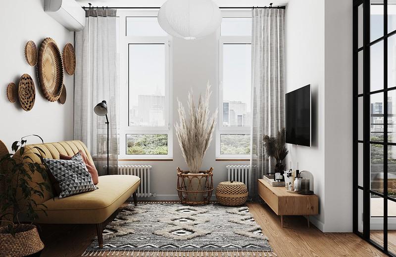 """Căn hộ có tầm nhìn thông thoáng nhờ khung cửa sổ rộng. Với phong cách hiện đại, những vật dụng thuần nông như chiếc mẹt, chiếc sàng lại trở thành vật trang trí """"đắt giá."""""""