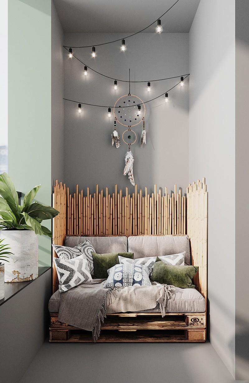 Ghế pallet làm từ gỗ và tre tạo nên một nơi thư giãn thú vị, cạnh ban công