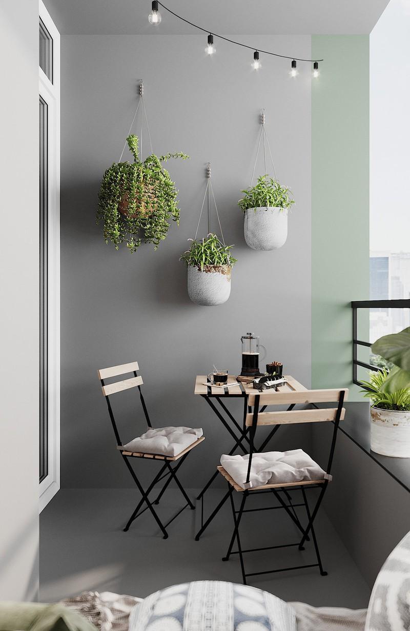Bộ ba chậu cây treo độc đáo, tạo nên một bối cảnh hấp dẫn đằng sau bộ bàn ghế uống trà