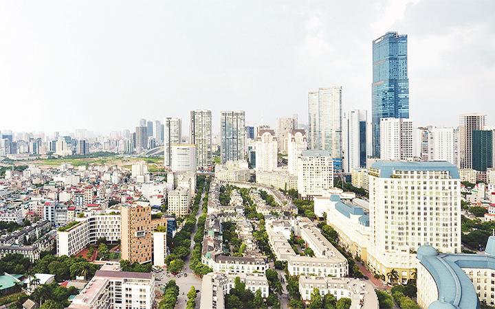 """Thủ đô Hà Nội sẽ đẩy nhanh tốc độ đô thị hóa, phát triển các đô thị vệ tinh theo Chương trình """"Chỉnh trang, phát triển đô thị và đẩy mạnh kinh tế đô thị giai đoạn 2021 - 2025"""". Trong ảnh: Một góc đô thị Hà Nội. Ảnh: DUY LINH"""