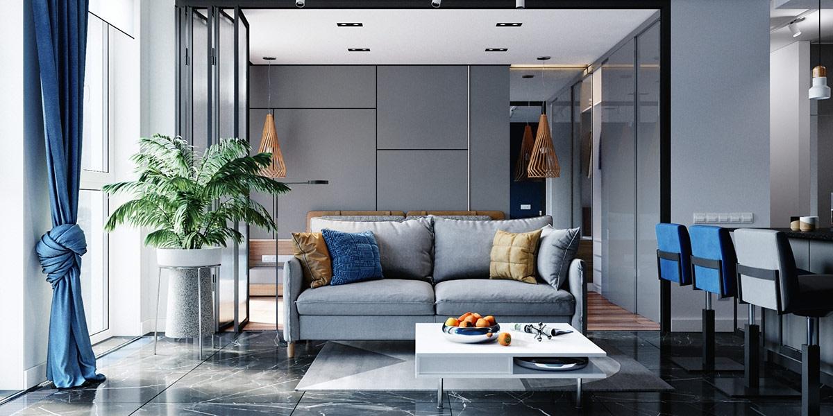 Nội thất phòng khách màu xanh lam, kết hợp điểm nhấn là gối tựa màu vàng và cây xanh trang trí