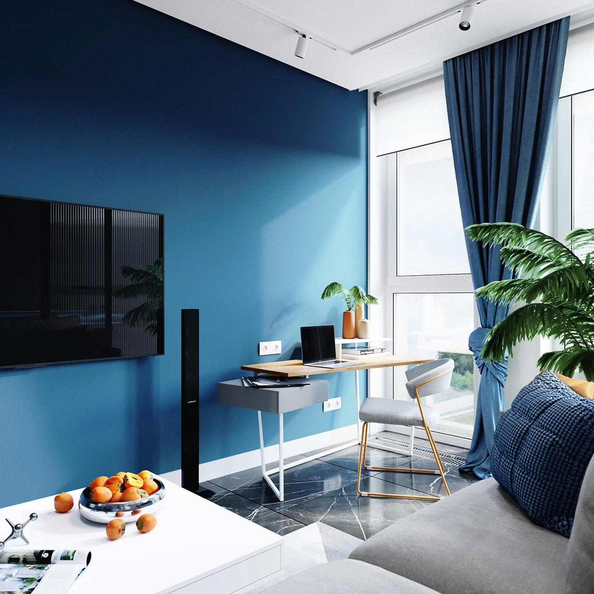 Bức tường màu xanh tiếp tục phía sau bàn làm việc tại nhà