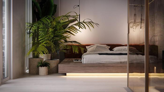 Phòng ngủ với số lượng nội thất tối giản. Nhà thiết kế vẫn bài trí những chậu cây xanh để giúp không gian thêm sinh động.