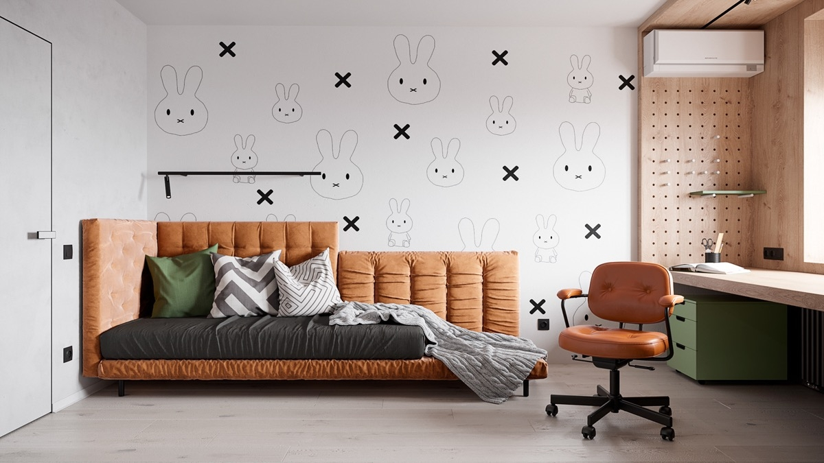Ghế màu cam nổi bật trên bức tường hình thỏ ngộ nghĩnh