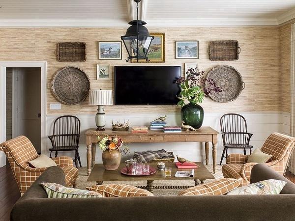 """Gam màu này mang lại cảm giác ấm cúng cho phòng khách. Thảm màu be với ghế sofa màu bí ngô cực """"ăn rơ"""" với nhau."""