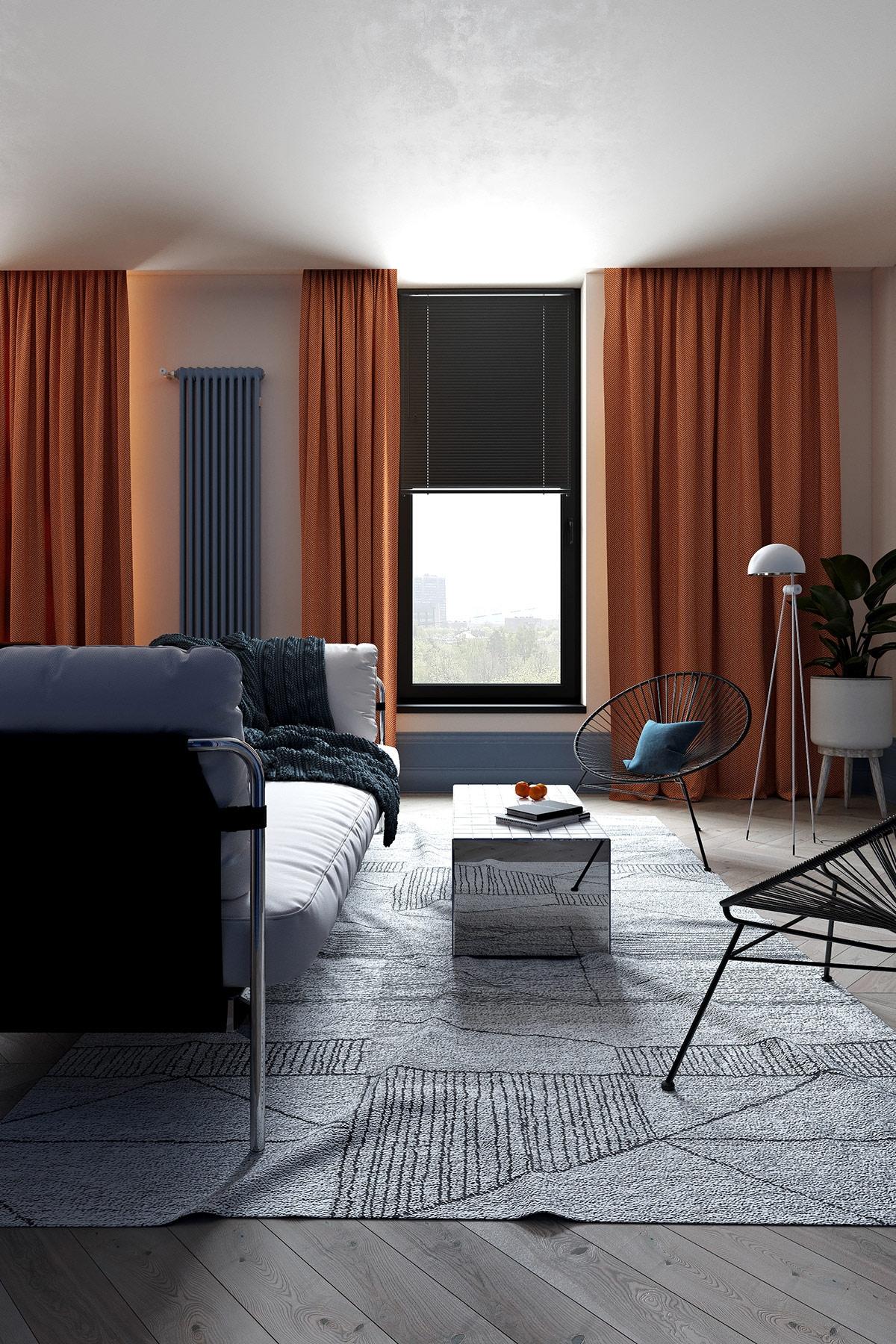 Những chiếc rèm màu cam giúp không gian phòng khách trở nên ấm cúng trong tiết trời lạnh giá và việc đan xen màu xanh dương dường như giúp căn phòng được dịu nhẹ hơn