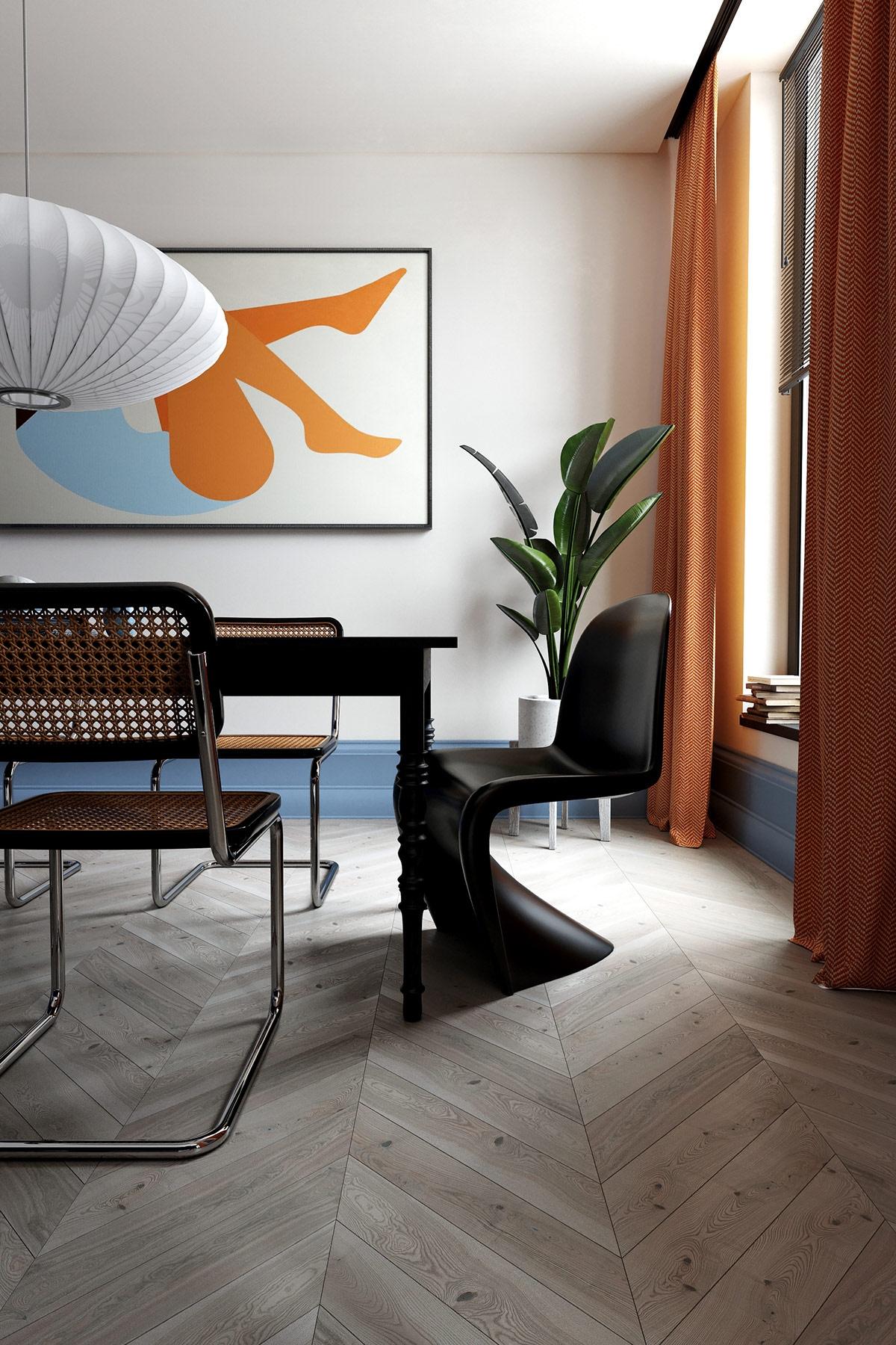 Bức tranh treo tường trừu tượng đi kèm với bộ bàn ăn tối màu mang lại sự thú vị, hấp dẫn trong không gian phòng ăn