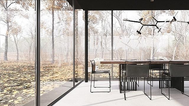 Căn nhà có hình chữ nhật được bố trí 2 không gian chính gồm phòng khách chung với bếp và một phòng ngủ. Trong đó, phòng khách gồm sofa, bàn ăn, khu bếp, phòng ngủ đặt một chiếc giường kèm bàn làm việc... được bố trí hướng ra ngoài có thể ngắm toàn cảnh thiên nhiên.