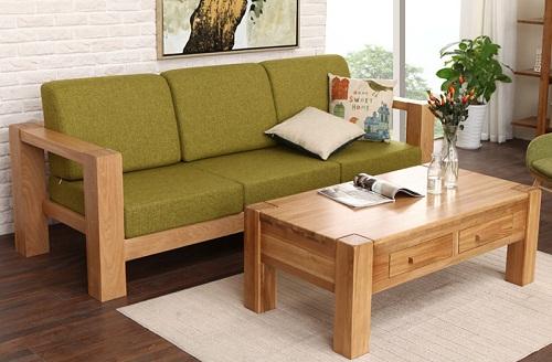 Bộ bàn ghế sofa phòng khách mini được thiết kế với kiểu dáng vô cùng đơn giản nhưng vô cùng nổi bật. Bộ bàn ghế sofa gỗ nhỏ gọn được kết hợp với đệm mút gam màu trầm tạo cảm giác ấm áp cho không gian phòng khách.