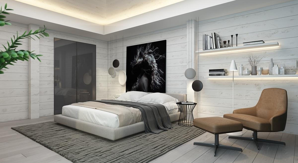 Căn phòng đơn sắc đầy tính nghệ thuật này sử dụng các tấm sơn trắng tinh tế làm nền cho bức chân dung tuyệt đẹp trên bức tường phía sau giường. Một tấm thảm họa tiết nổi bật thu hút ánh nhìn về phía tác phẩm nghệ thuật để tối đa hóa vị trí của nó như là tâm điểm của căn phòng. Chiếc ghế đơn màu nâu giúp cân bằng sự phân bố trọng lượng thị giác.