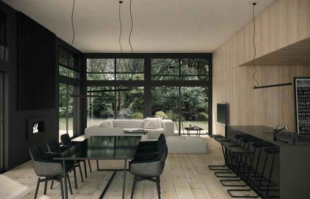 Một số nhà thiết kế ngại sử dụng đồ nội thất đơn sắc, màu tối nhưng với căn hộ này, màu đen được sử dụng tinh tế, đẹp mắt mà không làm không gian cảm thấy chật chội. Chủ nhân cân bằng với ghế sofa màu trắng và gỗ tự nhiên sáng màu.