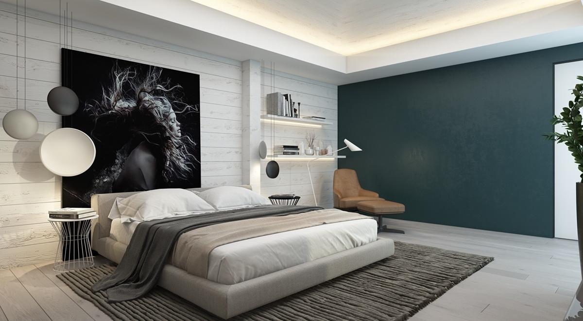 Màu xám trung tính chiếm ưu thế trong căn phòng, nhưng màu xám mờ trên bức tường phía xa chứa những gợi ý mạnh mẽ về màu xanh lam đậm.